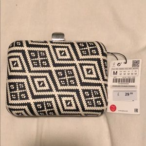 Zara black and white patterned clutch with strap